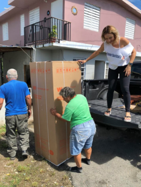 A disaster victim receives new appliances through the DCM program.