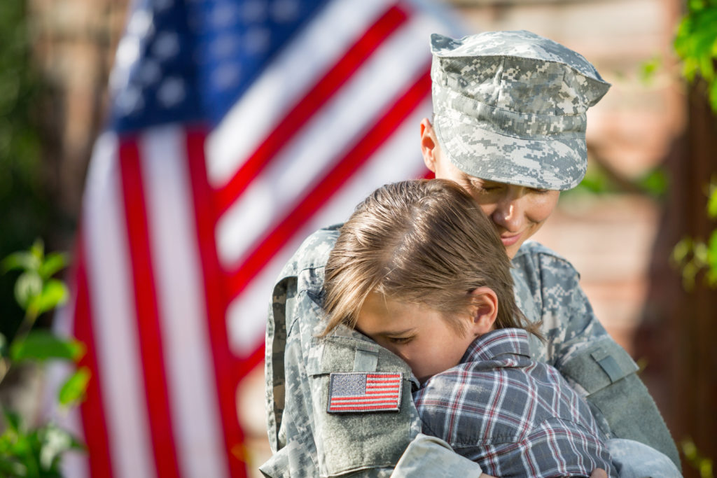 Female veteran and child