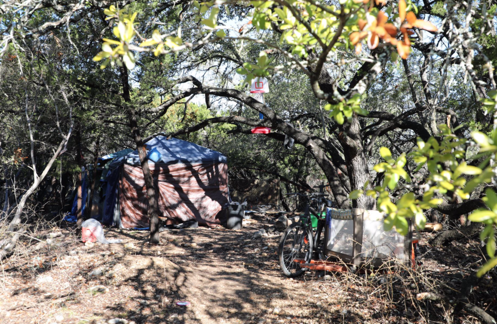 Playpen and basketball hoop outside a tent home made by San Antonio homeless family