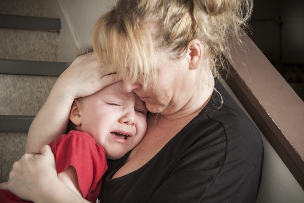 Homeless mother with crying child